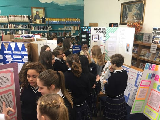 Lebanon Catholic School students examine seventh-grade science projects.