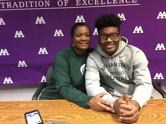 Ann Arbor Pioneer linebacker Antjuan Simmons and his mom, Tawan, on National Signing Day on Wednesday at Pioneer High School.