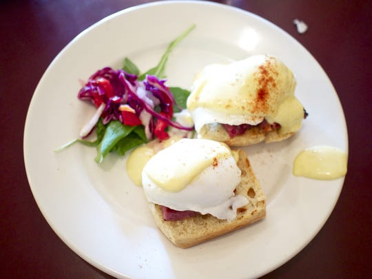 The Eggs Benedict at Salt Fork Kitchen is a split biscuit topped with a thick cut of ham, poached eggs and fresh hollandaise sauce.