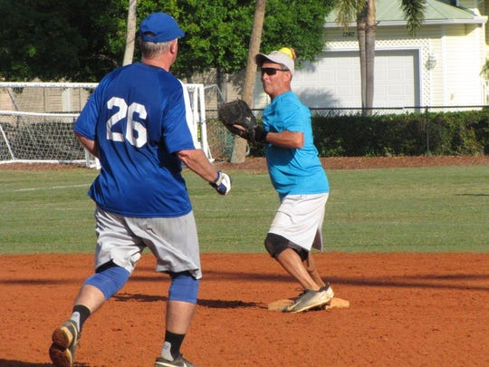 Jeff Kaczka of Nacho Mama's gets a force out at second base on Mutual of Omaha Bank's Phil Holmes.