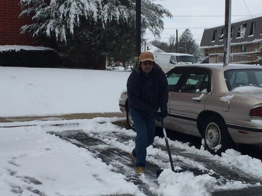 Ron Laudeman, a member of the Community Homes maintenance staff, clears a parking space at Poplar Terrace, 605 S. Eighth St., after a fast moving front dumped about five-inches of snow in Lebanon County early Thursday morning.
