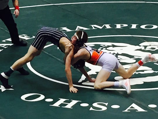 Ashland's 106-pounder Austin McNamara battles Carrollton's Nathan Blake en route to a 7-5 victory in Sunday's Division II quarterfinals of the state team wrestling tournament.