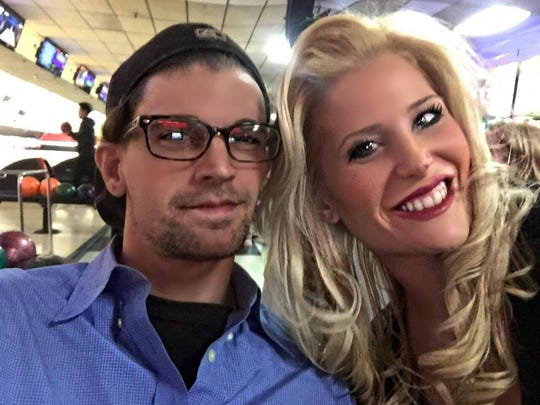 Stephen Senn and his girlfriend, Amy Wallace, appear in a photo taken before Senn died in a motorcycle crash on Feb. 5.
