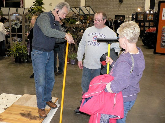 """Rubber brooms were the """"must buy"""" at the Garden Expo."""