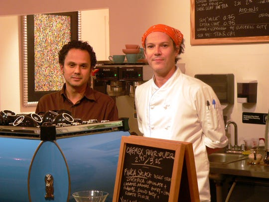 Mark Edmonds (right) and Christian Garcia in 2012 at the lunch counter of Patisserie, a French-inspired American bakery they opened in downtown Vero Beach.