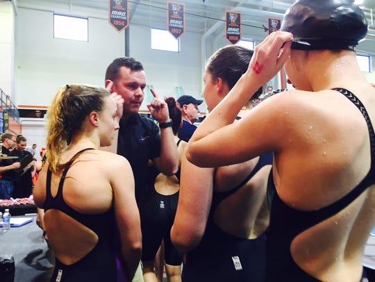Lexington coach Brock Spurling congratulates his team