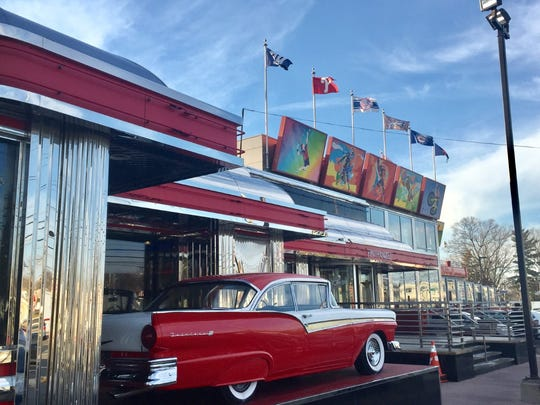 A vintage car sits on display outside the Phily Diner in Runnemede, which has been sued by two former servers.