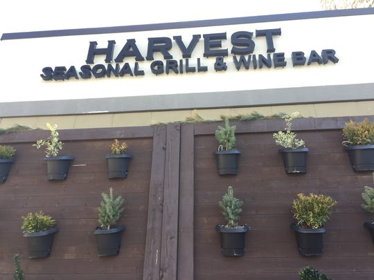 Harvest Seasonal Grill at Moorestown Mall faces a lawsuit alleging its workers' tips were improperly diverted.