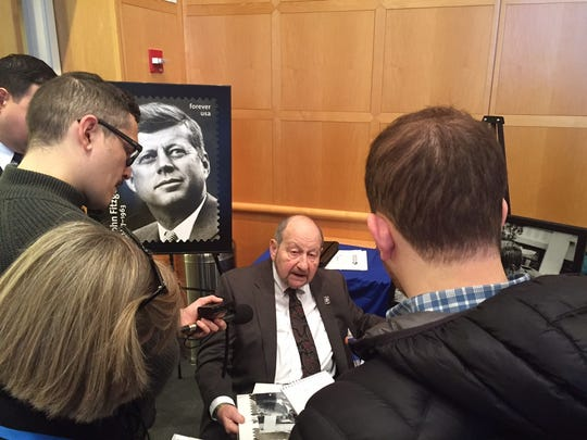 Photographer Ted Spiegel, of Fishkill, speaks to reporters in Boston Monday after the John F. Kennedy stamp unveiling ceremony.