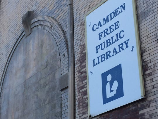 A sign identifies a former library on Federal Street in downtown Camden, now intended to become a redevelopment site.