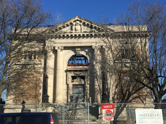 The former Carnegie Library on Broadway in Camden lost its roof decades ago.