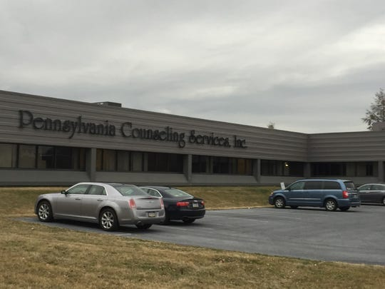 Cars are parked in the lot at the headquarters of Pennsylvania Counseling Services at 200 N. Seventh St. in Lebanon. The company is considering operating the day reporting center there, at least temporarily.