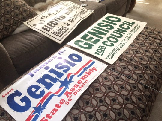 Campaign signs from James Genisio's runs for Oshkosh Common Council, and two bids for state assembly, at the home of University of Wisconsin Oshkosh Professor James Simmons.