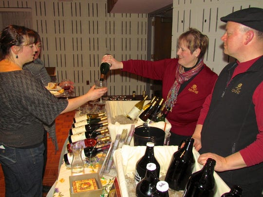 Representatives from Arbor Hill Winery pour a sample at last year's A Taste of Pittsford. Arbor Hill will return this year, along with more than two dozen fine dining establishments, Finger Lakes area wineries, craft brewers and spirit makers.