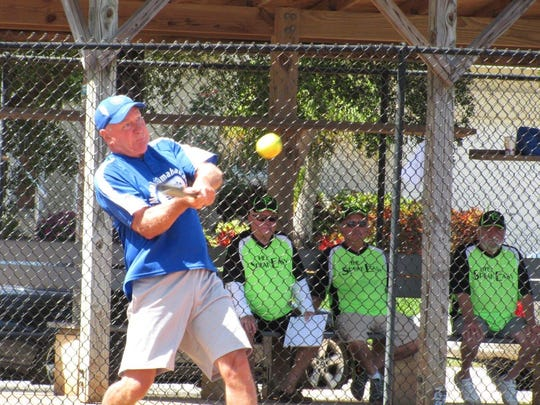 Murph Knapke drives the ball  for Mutual of Omaha Bank in game against Speakeasy.