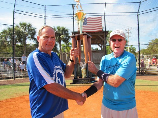League Commissioner Bill Shurina presents the Island Division championship trophy to Nacho's Mama's Manager George Schnorr.