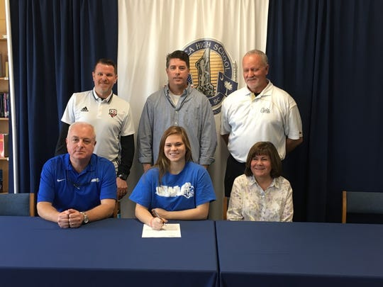 Leesee Chastain has signed her national letter of intent to play soccer at Southern Wesleyan University. She is with family and friends.