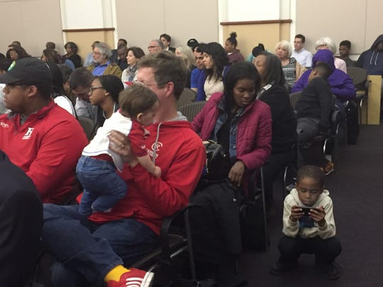 Audience members brought children to a meeting Monday