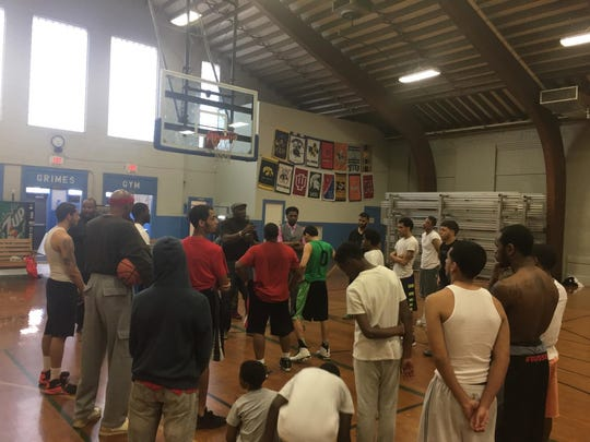 Shooting 4 Peace, a Baltimore-based program preaching non-violence and decision-making tools to youth, is coming to York. Here, former NFL player and Olympic bobsledder Greg Harrell and reformed gang member Ted Sutton talk to York youth at Voni Grimes Gym on April 5.
