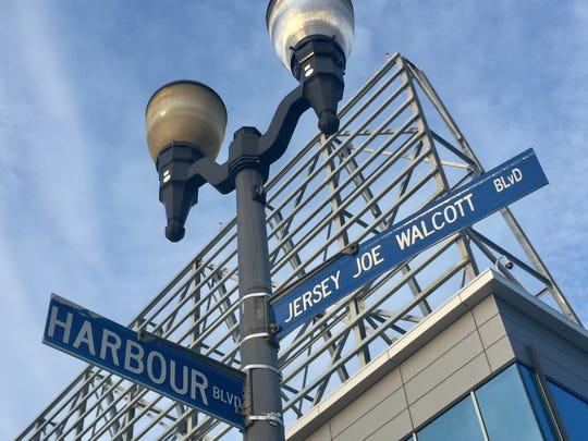 A street sign identifies Harbour Drive on Camden's Waterfront, which has been renamed Legends Lane.