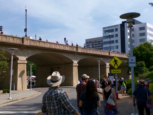 Marchers cross the bridge on Clinch Avenue during the Knoxville Climate March on Saturday, April 29.