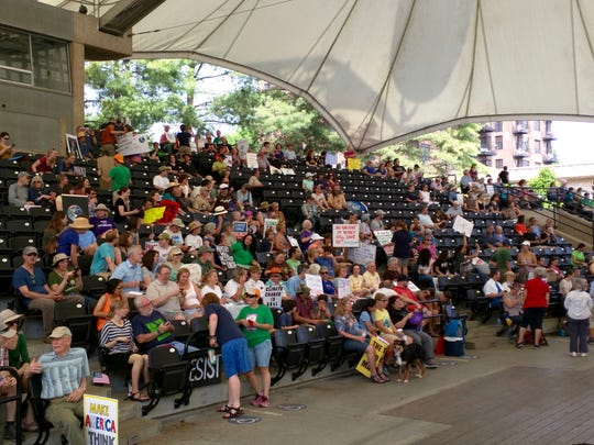 Marchers gather for a rally at Worlds Fair Park after the Knoxville Climate March on Saturday, April 29.