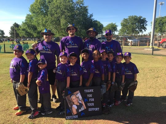 A Las Cruces Youth Baseball Association 6U team called the Roadrunners presented a check Wednesday to the family of Kaylynn Cuaron, a 14-year-old Vista Middle School student. Kaylynn returned to school Monday after being hospitalized due to experiencing cardiac arrest during a track meet April 28.