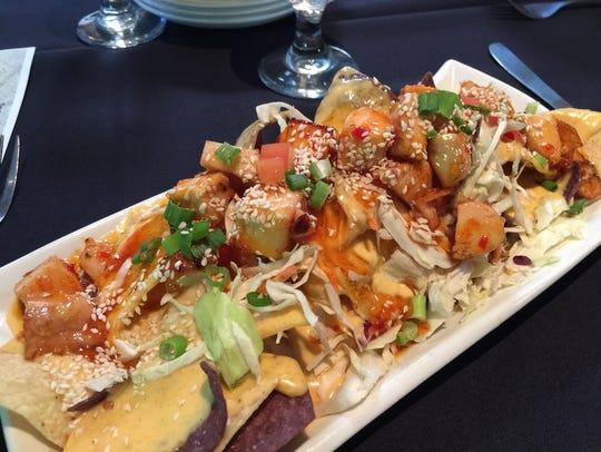 Colorful Thai chicken nachos appetizer at Westside