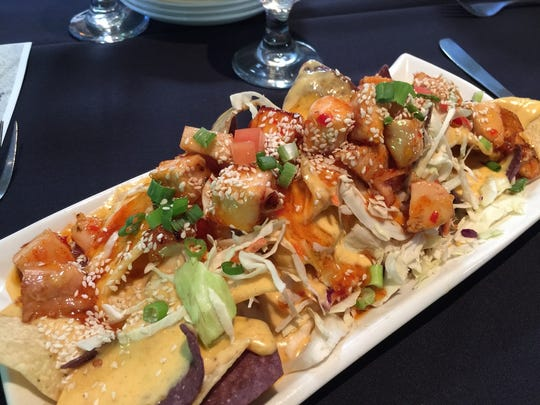 Colorful Thai chicken nachos appetizer at Westside Grill.