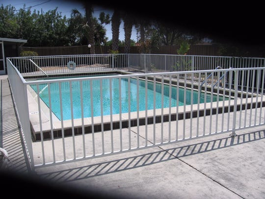 The metal fence that had been around the pool at 1330