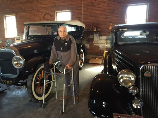 Richard Sloat, now 83, is selling his antique cars, a '23 Studebaker and a '43 Chevy.