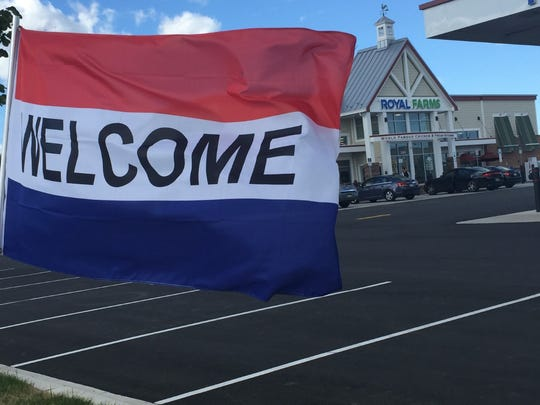 A welcome flag flutters outside a new Royal Farms convenience store in Philadelphia.