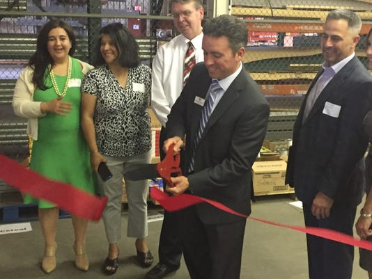 Craig-Rodenberger-Ribbon-Cutting-Power-Packs.jpg