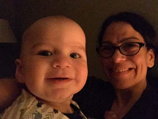 Victoria Freile with her night owl son as he's awake for the second time in an overnight.