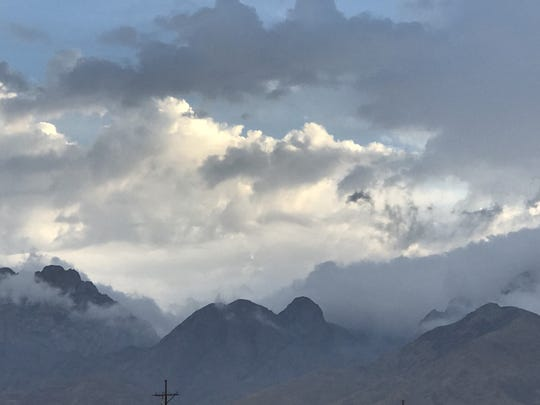 Clouds descend into the Organ Mountains.