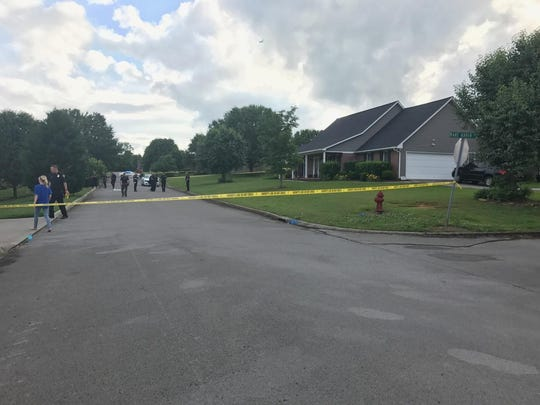 Police tape blocks a street in South Knox County after a man was killed in an armed confrontation with sheriff's deputies.
