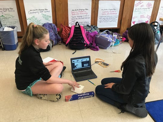 Chloe Maurice, left, and Josie Perretta, right, design a cat guitar on a computer during a STEM club meeting at Washington School in Wyckoff. The pair are part of a new girls-only science club in Wyckoff.