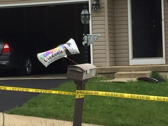 A graduation balloon marks the home where a male was shot early Sunday morning during a party in Manchester, police said.