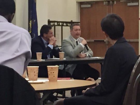 Regupol America President George Soukas (l) listens as Nathan Bryner  human resources director at Bell & Evans speaks during Wednesday's Workforce Alliance Summit at HACC-Lebanon Campus.