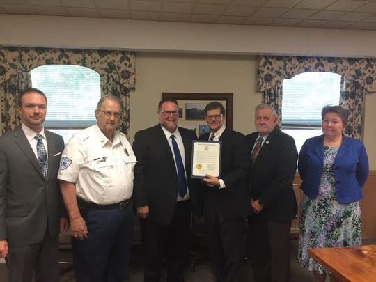 The Lebanon County commissioners (from right) Jo Ellen Litz, Bill Ames and Bob Phillips present a  proclamation declaring Msy 21-17 EMS week to First Aid & Safety Patrol Ex. Dir. Bryan Smith, Jim Rittle of the Lebanon County Ambulance Associaition and Bob Dowd, director of Lebanon County Emergency Management Agency.