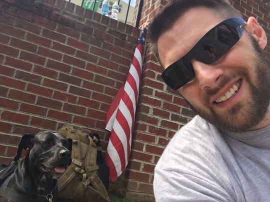 Holmdel Police Officer Michael Dowens was accompanied for a time by his service dog, Emery, on a trek from Washington, D.C. to East Brunswick last week to raise funds and awareness for post-traumatic stress disorder.