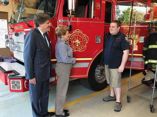 Franklin Lakes Council fire department liaisons Charles Kahwaty and Paulette Ramsey get an engine tour from fire chief Ryan Dodd.