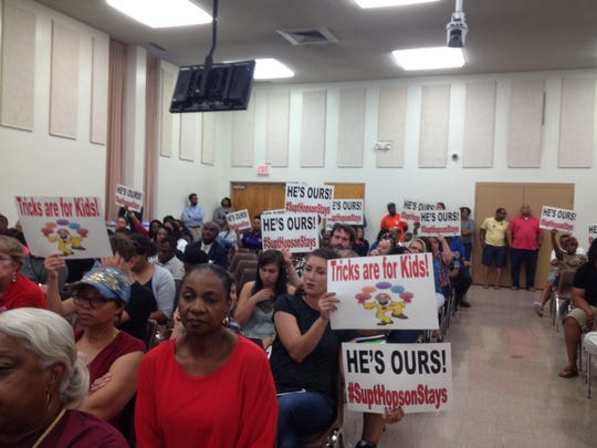 Supporters of Superintendent Dorsey Hopson hold signs supporting him during the June 8 specially called meeting. Among them is parent Kristin Carlin, in the center.