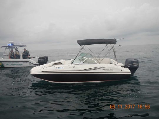 """This 18-foot """"Grady White"""" motorboat owned by Tony Hughes was found Sunday empty and circling in the waters about 7 miles off the Sebastian Inlet."""
