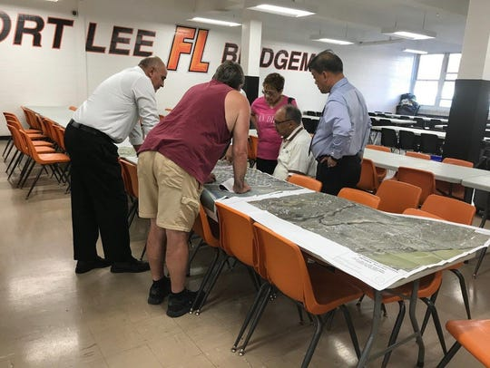 Residents pour over maps relating to bridge project