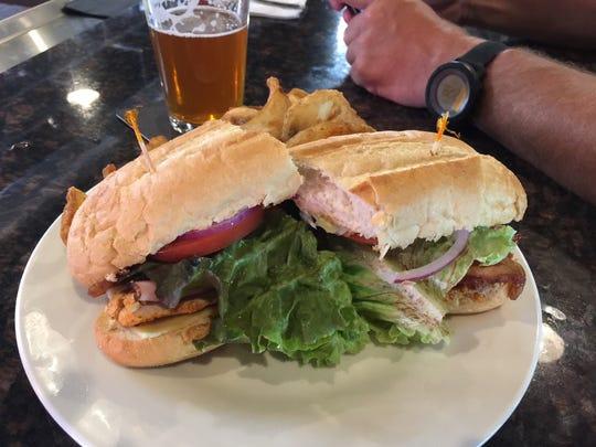 Joe Wall rewards himself with a beer and a turkey club sandwich after summiting Mt. Shasta