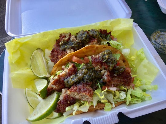 Tacos with Lao sausage and spicy jalapeño sauce at