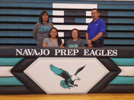 Alyssa Wilson, sitting left, signs a letter of intent