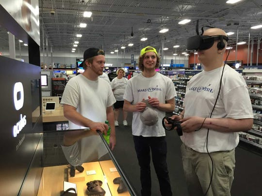 Seth, accompanied by his brothers, checks out a virtual