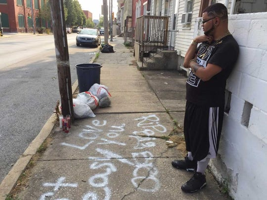 In this file photo from July 17, 2017, Brandon Groff-Wood, 32, stands near a memorial on West Philadelphia Street in York for Angel Hernandez, 20, of York, who was shot and killed the previous day.